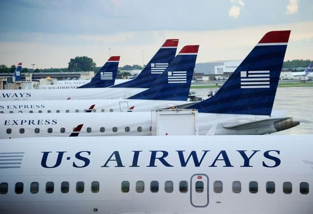US moves for blocking merger of US Airways and American Airlines